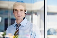 Smiling businessman with headset
