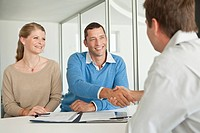 Smiling professionals at meeting in office (thumbnail)