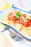 italian food pasta with tomato cheese and parsley