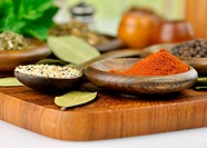 arrangement of spices on a wooden board , close up shot