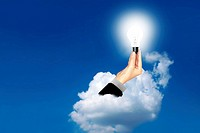 Bulb light in business woman hand on the sky the clouds