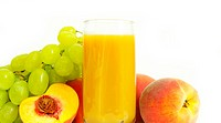 Glass with freshly made peach juice on a white background