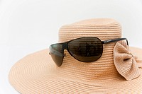 Sunglasses and a hat for summer season on white background