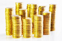 Piles of gold coins against white background