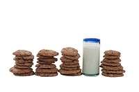 Cookies arranged in a row, with a glass of milk.
