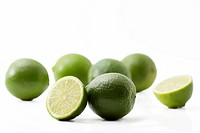 some limes and halfes on on white background