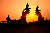 Indonesian old temple Pura Besakih. Temple gate at red sunset light. Bali
