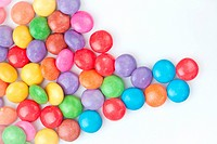 Multicolored candies against a white background