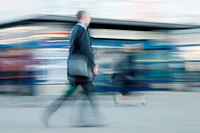 Blurred image of businessman rushing to office in the morning