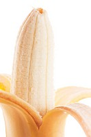 Closeup view of peeled banana isolated over white.