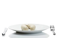 bavarian veal sausages on a plate on white background