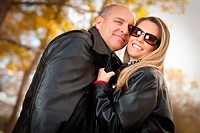 Happy, Attractive Couple in Park with Leather Jackets.