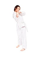 full_length isolated portrait of beautiful martial arts girl in kimono excercising karate kata