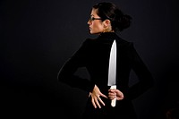 Pretty Woman holds a knife behind her back