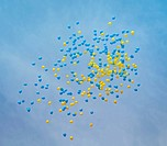 balloons over blue sky
