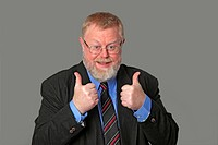 Thumbs up business man on grey background