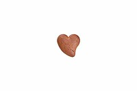 a cookie made of chocolate in heart shape, isolated on white background