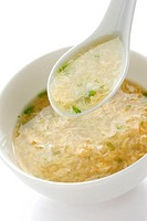 egg drop soup , egg flower soup , on a white background