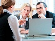 Mid_adult couple meeting with agent or financial advisor