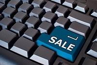 Blue sale button on black keyboard