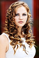 portrait young brunette girl serious long curly locks