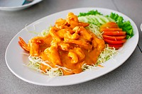 fried shrimp with orange sauce and vegetables , Asian style food