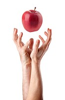 Man and woman hand trying to catch an apple