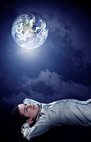 Young man dreaming to his future on earth