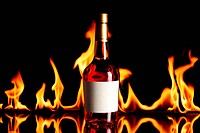 wine brandy bottle with fire flames in the background