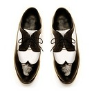 Two_tone black and white patent leather men´s shoes on white