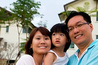 Happy family portrait at outdoor, smile and looking into camera
