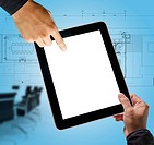 business hand point on interior layout plan on tablet computer as meeting concept