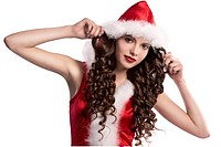 beautiful teen brunette with long curls wearing a red santa claus costume with white fur