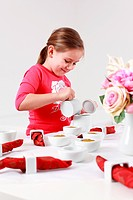 Girl helps to set table
