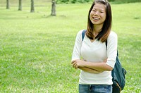 asian girl smiling with green backgrond