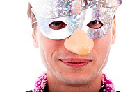 Smiling man wearing party mask, isolated on white background.