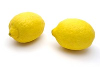 Two Fresh lemons closeup on white background