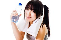 Portrait of a Chinese woman holding a water bottle after a workout.