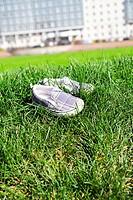 Children´s footwear on a green grass