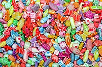 Multi color plastic beads variety assortment background