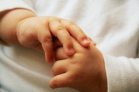 Beautiful little hands of the sleeping baby