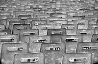 Plastic chairs set up for a speech