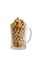 High glass beer mug filled with salted pistachios