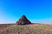 Stone pyramid at mountain peak