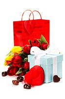 gift boxes, chocolate and flowers for Valentine´s day  on white background.