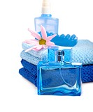 man toilerties _ blue perfume bottle and towels on white background