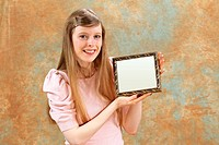 Young blonde girl holding empty vintage frame