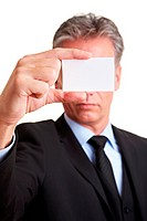 Manager holding white business card in front of his face