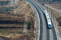 view of a high_speed train crossing a arid landscape in Purroy, Saragossa, Aragon, Spain, AVE Madrid Barcelona