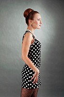 beautiful lady in a polka dot dress. 60s style